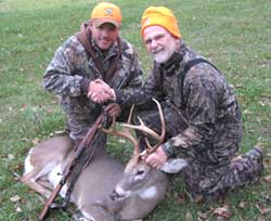 Hunters with buck
